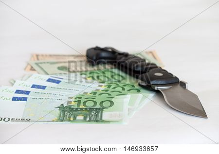 criminal concept,  knife put on American dollar and euro