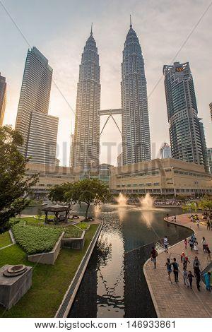 KUALA LUMPUR, MALAYSIA - AUGUST 20, 2016 : The Petronas Twin Towers in Kuala Lumpur, Malaysia are the world's tallest twin tower. The skyscraper height is 451.9m