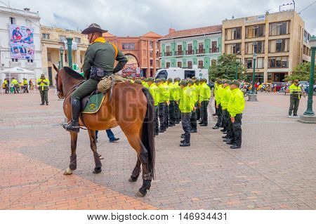PASTO, COLOMBIA - JULY 3, 2016: unidentified police officer monted on a horse next to some unidentified cops.