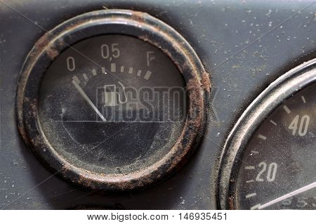Cropped macro shot of a retro fuel gauge. Filtered image