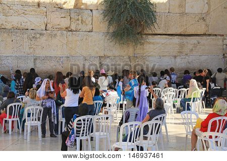 JERUSALEM, ISRAEL, OCTOBER 24, 2013, Jewish  women praying at the womens side of the Western Wailing Wall which is also known as the Kotel, the most holy site for Jews in Jerusalem, Israel.