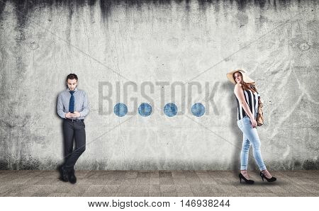 Beautiful women walking and looking behind to a businessman using a phone drawing dots on wall. The concept of communication
