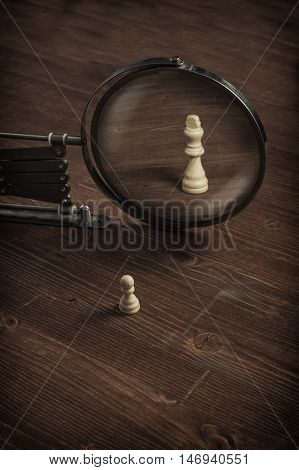 Chess pawn looking into the mirror and see himself as a king.