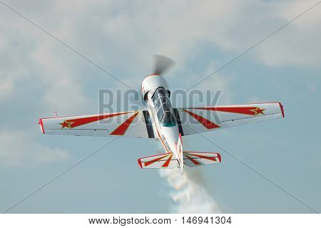 Zhitomir Ukraine - June 17 2011: Yakovlev Yak-52 light trainer and aerobatic plane is performing the loop
