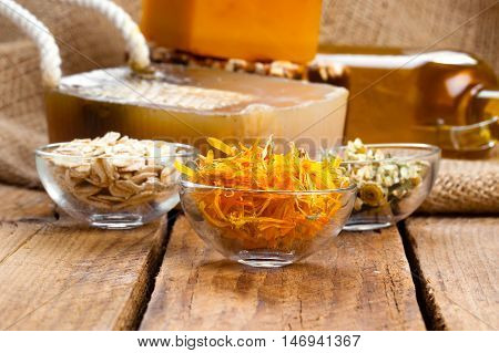 marigolds herb soap. natural cosmetic on wooden background