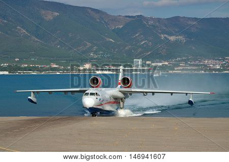 Gelendzhik Russia - September 8 2010: Beriev Be-200 amphibian plane is getting out of the water to land