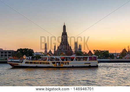 Wat Arun and cruise ship in twilight time Bangkok city Thailand