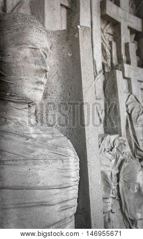 Stone statue of a mummy in a coffin