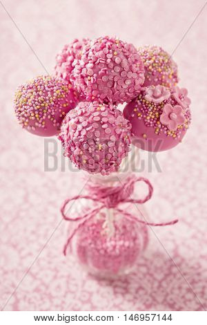Pink cake pops in a vase