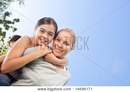 Mother And Her Daughter Laughting In The Park