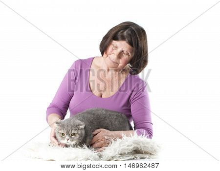 Elderly woman with a cat breed Scottish Fold. Studio photography on a white background.