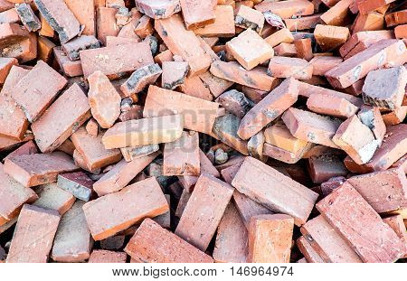 Close Up Pile Of Orange Brick At Construction Site