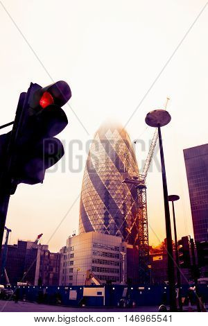 View Of Gherkin Tower In London Photographed From Below A Traffic Light