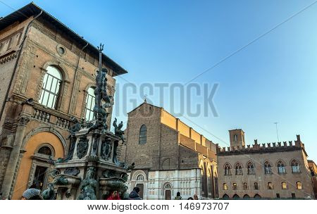 Bologna, Italy - December 27, 2015: day view of Neptune Statue and Piazza Maggiore in Bologna Italy. Neptune Statue is a famous monument of the italian Renaissance.