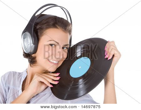 Emotional Brunette In Headphones With Vinyl Record Over White