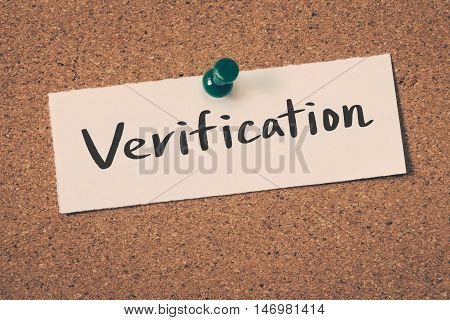 Verification note pin on the bulletin board