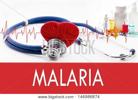 Medical concept malaria. Stethoscope and red heart on a white background