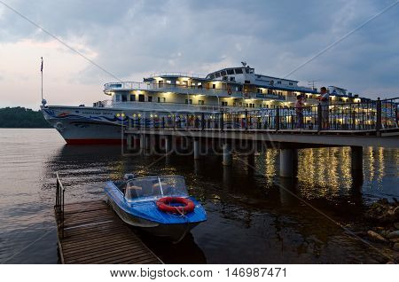 PLES RUSSIA - JULY 20 2016: Unidentified people are on river quay near cruise ship