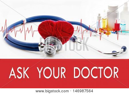 Medical concept ask your doctor. Stethoscope and red heart on a white background