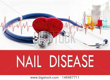 Medical concept nail disease. Stethoscope and red heart on a white background