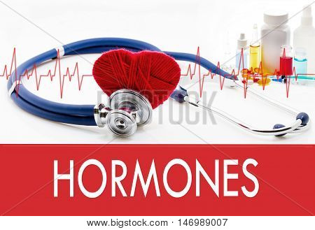 Medical concept hormones. Stethoscope and red heart on a white background