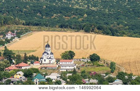 Landscape view with Capriana Monastery and the village in Moldova surrounded by forest
