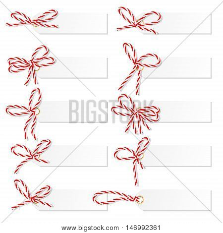 Set of tag labels with red rope bakers twine bows on white background