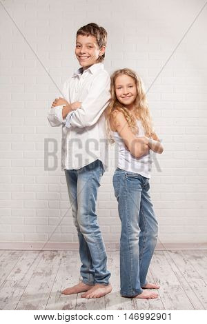 Children in jeans. Boy and girl models.