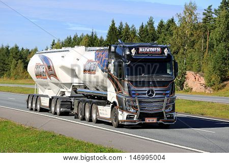 SALO, FINLAND - SEPTEMBER 9 2016: Mercedes-Benz Actros Uniq Concept the latest super bulk transport truck of Kuljetus Auvinen trucking along freeway on a sunny day in late summer.