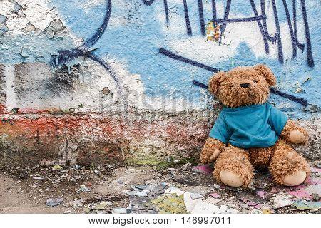 Teddy bear of homeless child left on the ground