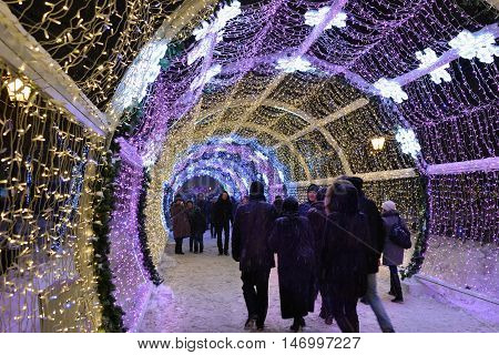 MOSCOW RUSSIA - JAN 16 2016: Moscow winter street scene. People walking along the Tverskoy bulvar during annual festival Christmas light