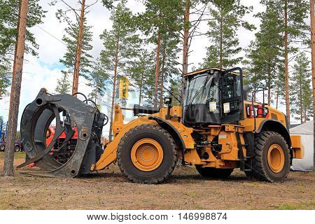 JAMSA, FINLAND - SEPTEMBER 2, 2016: CAT 972M XE wheel loader with grapples for forest industry on display on the heavy machinery exhibition FinnMETKO 2016.