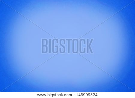Abstract blue background with spotlight paper texture
