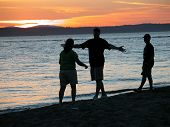 pic of reunited  - friends reuniting on the beach at sunset - JPG