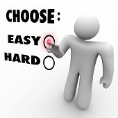stock photo of beside  - A man presses a button beside the word Easy when asked to choose a difficulty level - JPG