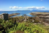 stock photo of eigg  - Isles of Eigg and Rum from Arisaig on the Road to the Isles - JPG