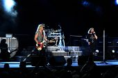 DUBLIN - JUNE 12 : Joe Elliot (R) and Rick Savage (L) of Def Leppard rock group on stage during thei
