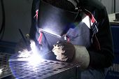 stock photo of tig  - Tunsten inert Gas welder working on a small plate - JPG