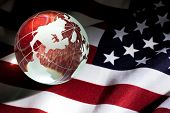 stock photo of waving american flag  - Globe and USA Flag for background use - JPG