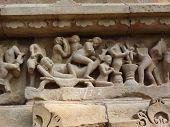 image of kama  - Sculptures of loving couples illustrating the Kama Sutra on walls of Varaha Temple Khajuraho in India Asia - JPG