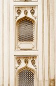 picture of charminar  - Nijam style windows on historic 400 year old charminar in India - JPG