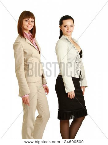A full-length portrait of businesswomen posing, isolated on white, side-view