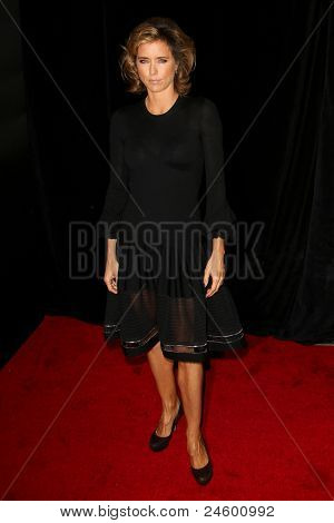 "NEW YORK - OCTOBER 24: Tea Leoni attends the premiere of ""Tower Heist"" at the Ziegfeld Theatre on October 24, 2011 in New York City."