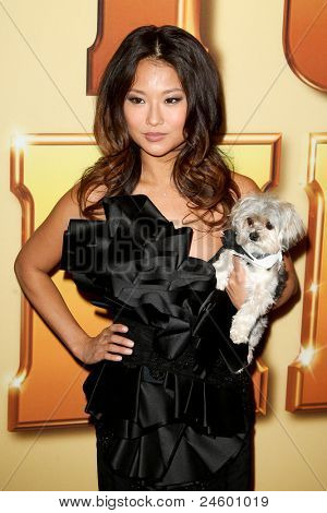 """NEW YORK - OCTOBER 24: Anna Park and Lucky the dog attend the premiere of """"Tower Heist"""" at the Ziegfeld Theatre on October 24, 2011 in New York City."""