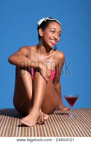 Beautiful Smiling African Woman Sitting In Sun