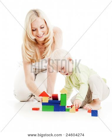 Mother and son playing building blocks together isolated on white