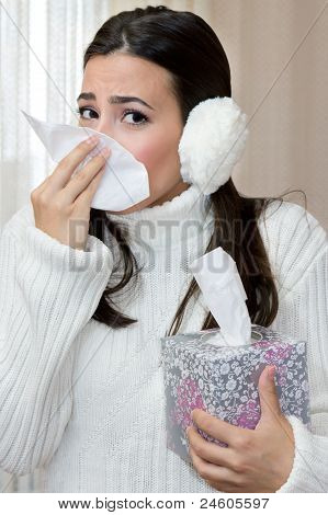 Teenage Girl Blowing Nose