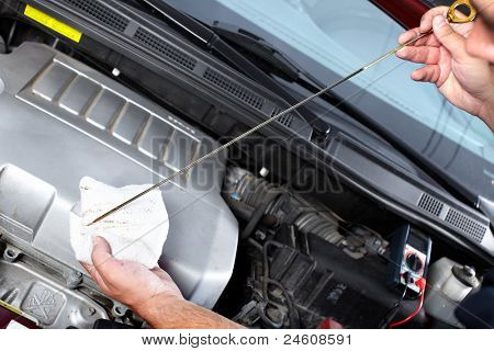 hands of mechanic working in auto repair shop.