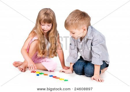 Two Playing Kids With Alphabet Isolated On White Background