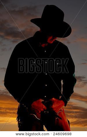 Cowboy In Sunset Looking Down